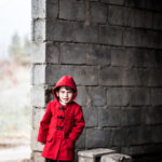 Iraqi Christian child wearing new coat provided by ICC.