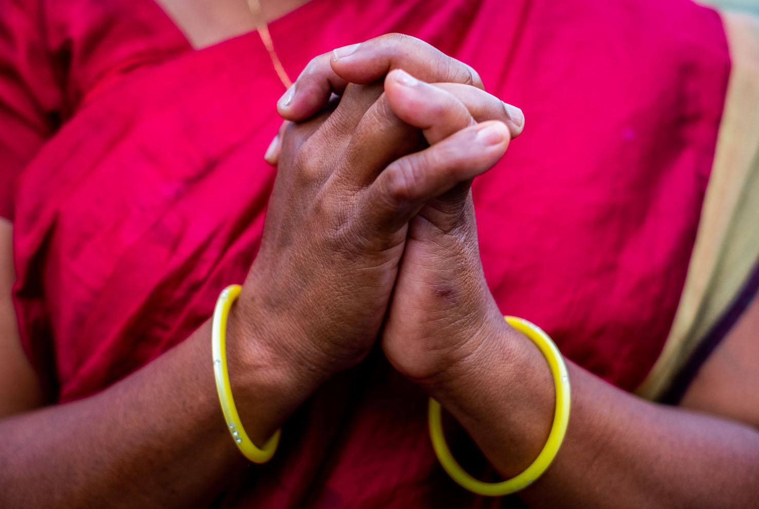A widow in Kandhamal, India, folds her hands in prayer. During the Summer of 2008 a mob of Hindu nationalists aligned with the BJP party murdered her husband before her eyes for their Christian faith. After 10 years, she, along with other widows who faced the same fate, still gather together to encourage each other and worship Jesus Christ together. Kandhamal, India. 2018
