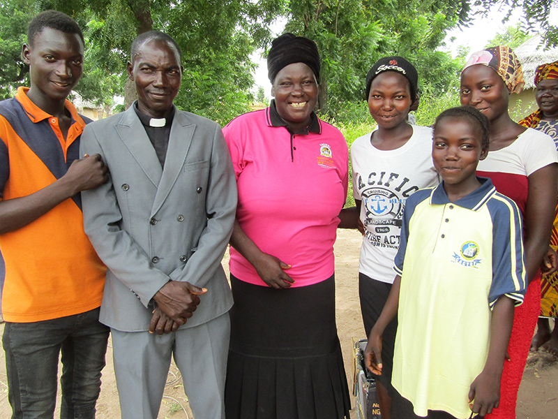 Marice and her family stand together after suffering a Fulani attack.